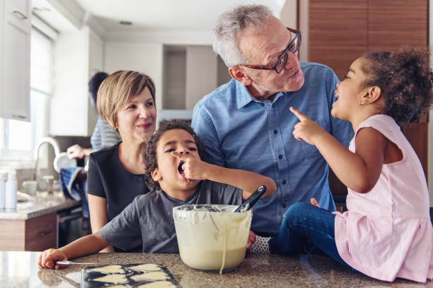 Grandparents making cupcake with kids