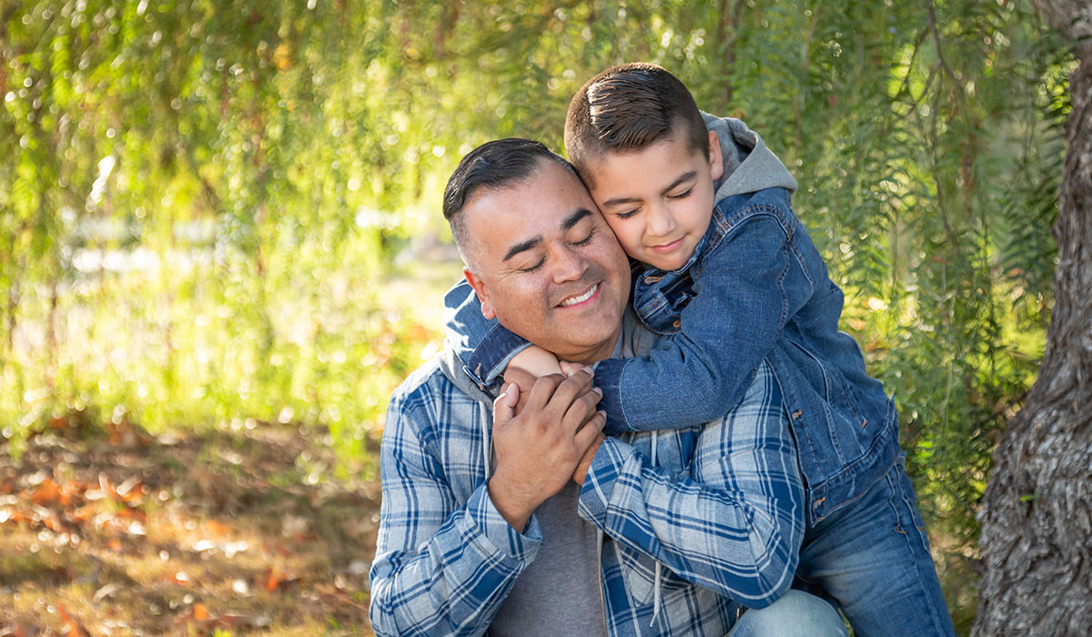 Son embracing father